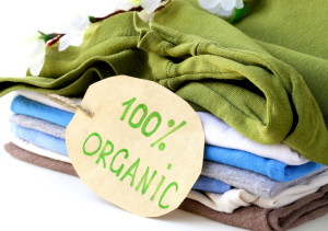 stack of multicolored clothing with 100% organic label